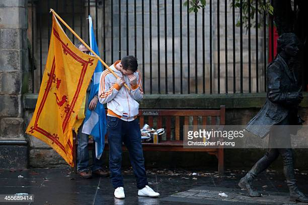 Dejected Yes vote campaigners make their way home along the Royal Mile after the people of Scotland voted no to independence on September 19 2014 in...