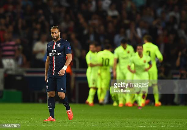 A dejectedof PSG walks up the pitch as Luis Suarez of Barcelona celebrates scoring their second goal with team mates during the UEFA Champions League...