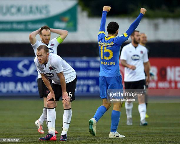 Dejection at the final whistle for Chris Shields of Dundalk as Makisim Zhaunerchyk of BATE Borisov celebrates during the Champions League 2nd round...