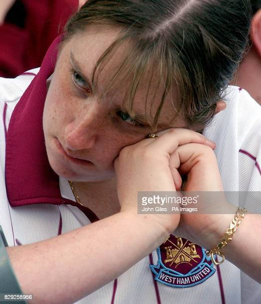 Dejection for a West Ham fan at the game against Birmingham as the news that Bolton had gone two goals up against Middlesbrough made the relegation...