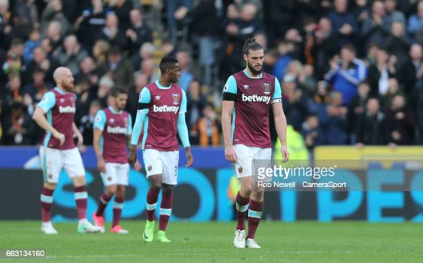 Dejection for Andy Carroll of West Ham United and his team mates during the Premier League match between Hull City and West Ham United at KCOM...