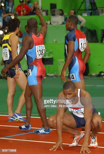 Dejection for Darren Campbell after he was just out of the medals in the 200m Final at the Athletics World Championships as John Capel the winner...