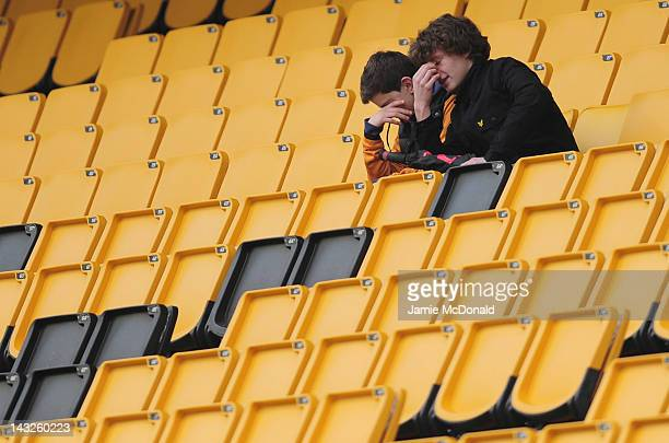 Dejection for fans of Wolves during the Barclays Premier League match between Wolverhampton Wanderers and Manchester City at Molineux on April 22...