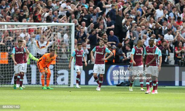Dejection for West Ham during the Premier League match between West Ham United and Liverpool at London Stadium on May 14 2017 in London England