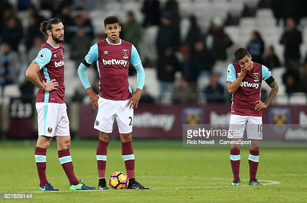 Dejection for West Ham's Andy Carroll Ashley Fletcher and Manuel Lanzini during the Premier League match between West Ham United and Arsenal at...
