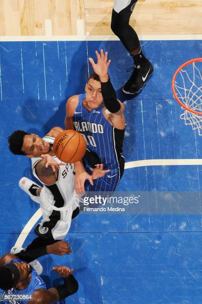 Dejounte Murray of the San Antonio Spurs and Aaron Gordon of the Orlando Magic vie for the ball during the game on October 27 2017 at Amway Center in...