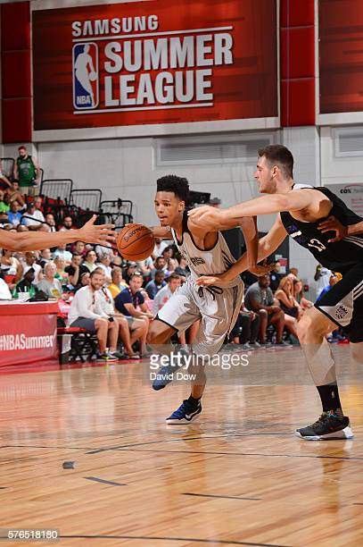 Dejounte Murray of the San Antonio Spurs drives to the basket against the Sacramento Kings during the 2016 NBA Las Vegas Summer League game on July...