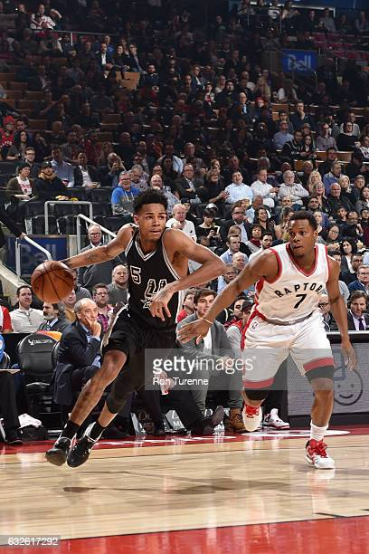 Dejounte Murray of the San Antonio Spurs drives to the basket against Kyle Lowry of the Toronto Raptors during the game on January 24 2017 at the Air...