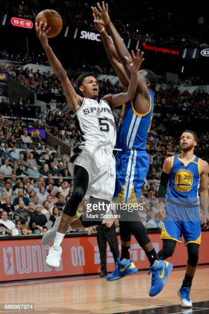 Dejounte Murray of the San Antonio Spurs goes to the basket against the Golden State Warriors during Game Four of the Western Conference Finals of...