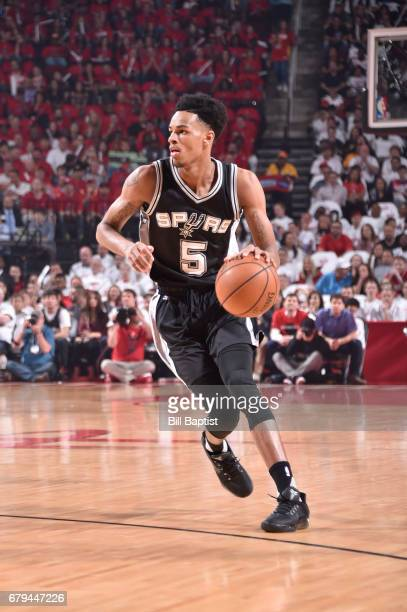 Dejounte Murray of the San Antonio Spurs handles the ball against the Houston Rockets during Game Three of the Western Conference Semifinals of the...