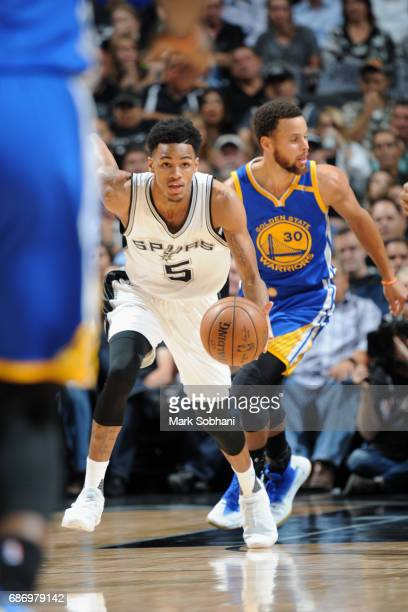 Dejounte Murray of the San Antonio Spurs handles the ball against the Golden State Warriors during Game Four of the Western Conference Finals of the...