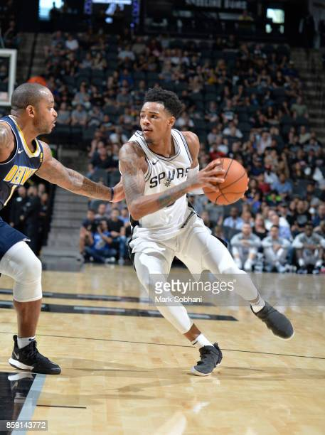 Dejounte Murray of the San Antonio Spurs handles the ball against the Denver Nuggets during the preseason game on October 8 2017 at the ATT Center in...