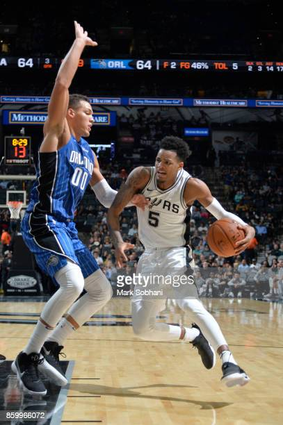 Dejounte Murray of the San Antonio Spurs handles the ball against the Orlando Magic during a preseason game on October 10 2017 at the ATT Center in...