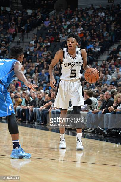 Dejounte Murray of the San Antonio Spurs handles the ball during a game against the Dallas Mavericks on November 21 2016 at the ATT Center in San...