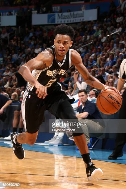 Dejounte Murray of the San Antonio Spurs handles the ball during the game against the Oklahoma City Thunder on March 9 2017 at Chesapeake Energy...