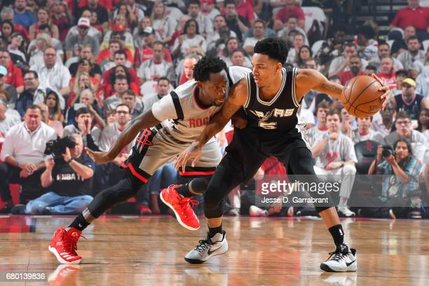 Dejounte Murray of the San Antonio Spurs handles the ball during the game against Patrick Beverley of the Houston Rockets during Game Four of the...