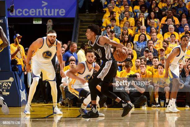 Dejounte Murray of the San Antonio Spurs handles the ball during the game against the Golden State Warriors during Game Two of the Western Conference...