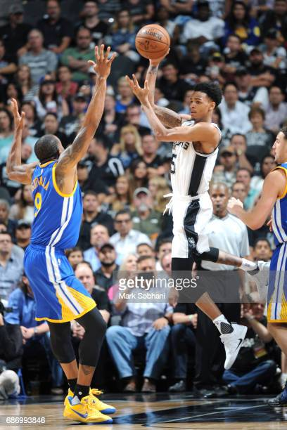 Dejounte Murray of the San Antonio Spurs passes the ball against the Golden State Warriors during Game Four of the Western Conference Finals of the...