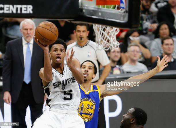Dejounte Murray of the San Antonio Spurs shoots the ball against Shaun Livingston of the Golden State Warriors in the first half during Game Four of...