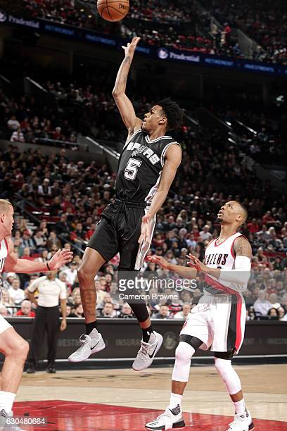 Dejounte Murray of the San Antonio Spurs shoots the ball during the game against the Portland Trail Blazers on December 23 2016 at the Moda Center in...