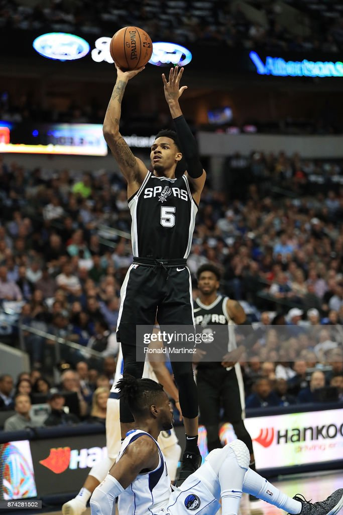 Dejounte Murray #5 of the San Antonio Spurs takes a shot against the Dallas Mavericks in the first half at American Airlines Center on November 14, 2017 in Dallas, Texas.