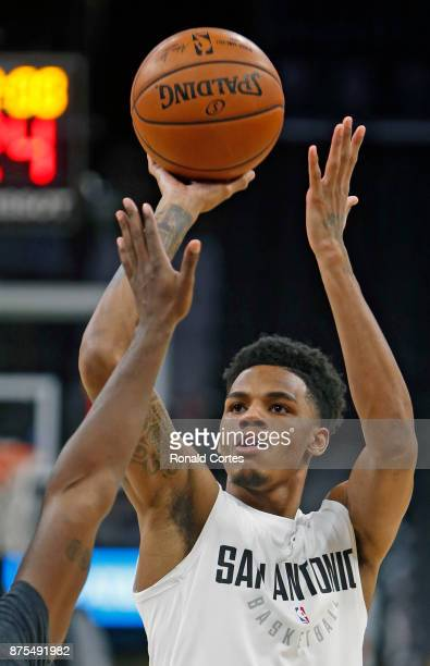 Dejounte Murray of the San Antonio Spurs takes practice shots before the start of their game against the Oklahoma City Thunder at ATT Center on...