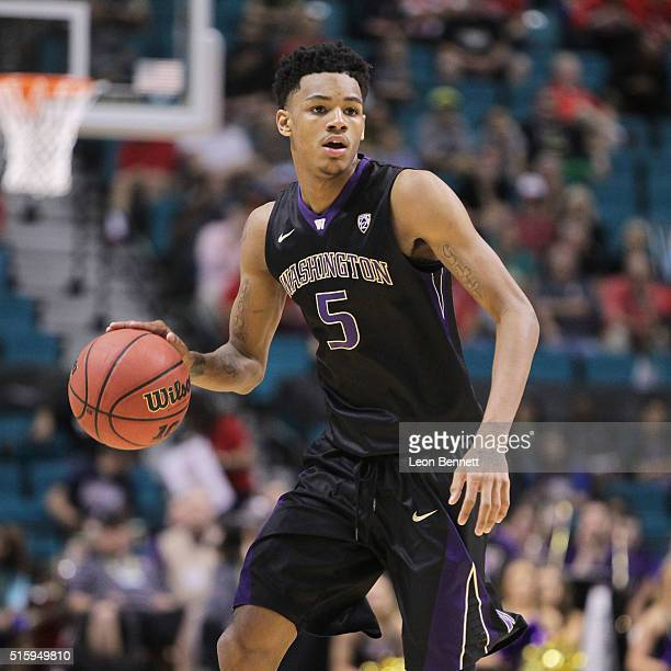 Dejounte Murray of the Washington Huskies handles the ball against the Oregon Ducks during a quarterfinal game of the Pac12 Basketball Tournament at...