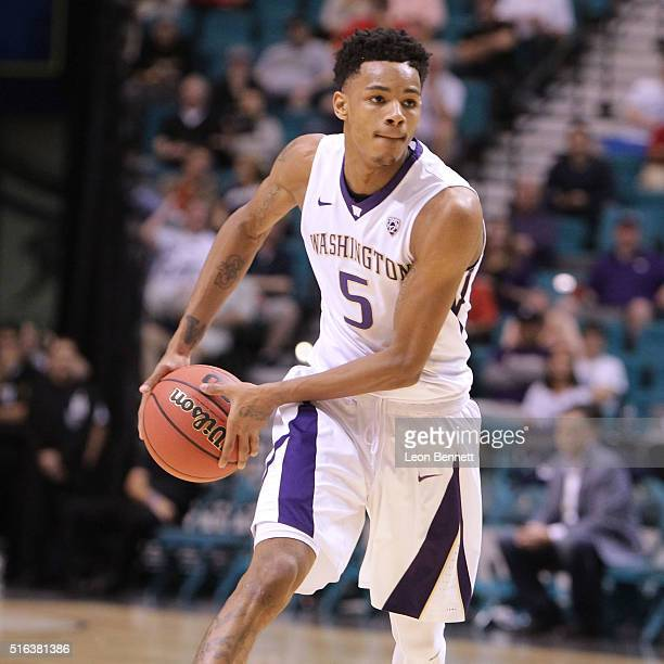 Dejounte Murray of the Washington Huskies handles the ball against the Stanford Cardinal during a firstround game of the NCAA Pac12 Basketball...