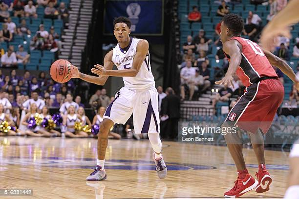 Dejounte Murray of the Washington Huskies handles the ball against Marcus Allen of the Stanford Cardinal during a firstround game of the NCAA Pac12...