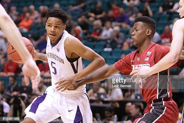 Dejounte Murray of the Washington Huskies handles the ball against Malcolm Allen of the Stanford Cardinal during a firstround game of the NCAA Pac12...