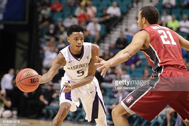 Dejounte Murray of the Washington Huskies handles the ball against Cameron Walker of the Stanford Cardinal during a firstround game of the NCAA Pac12...