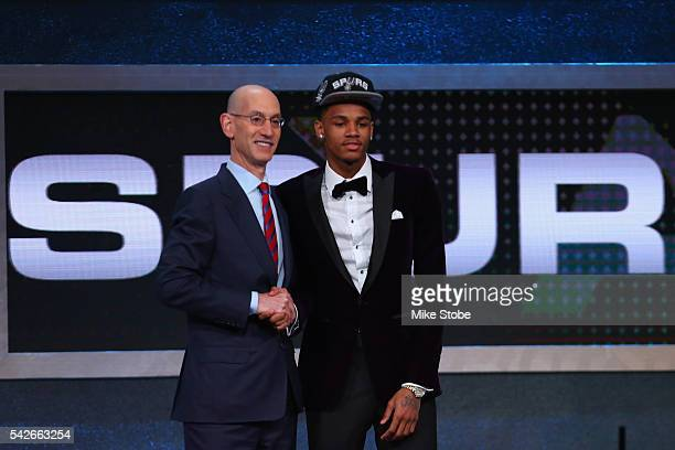 Dejounte Murray shakes hands with Commissioner Adam Silver after being drafted 29th overall by the San Antonio Spurs in the first round of the 2016...