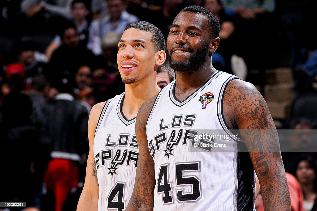 DeJuan Blair #45 and Danny Green #4 of the San Antonio Spurs share a laugh during a game against the Chicago Bulls on March 6, 2013 at the AT&T Center in San Antonio, Texas.