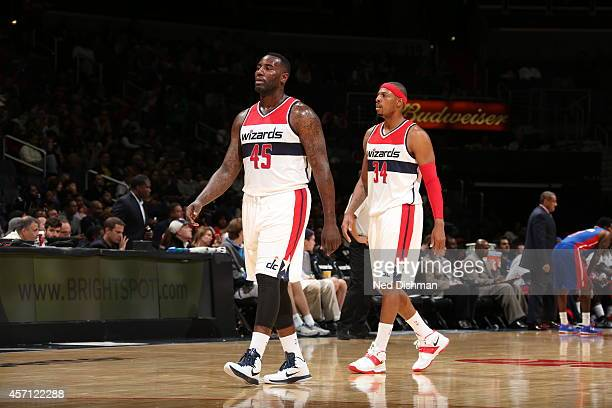 DeJuan Blair and Paul Pierce of the Washington Wizards walk toward the bench during the game against the Detroit Pistons on October 12 2014 at...