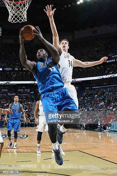 DeJuan Blair of the Dallas Mavericks drives to the basket against Jason Smith of the New Orleans Pelicans on December 4 2013 at the New Orleans Arena...