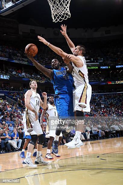 DeJuan Blair of the Dallas Mavericks goes up for the layup against the New Orleans Pelicans during an NBA game on December 4 2013 at the New Orleans...