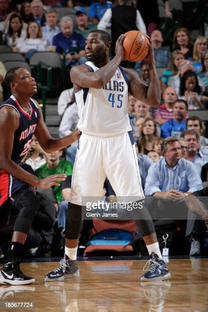 DeJuan Blair of the Dallas Mavericks handles the ball against Eric Dawson of the Atlanta Hawks on October 23 2013 at the American Airlines Center in...