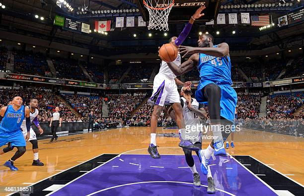 Dejuan Blair of the Dallas Mavericks passes against Jason Thompson of the Sacramento Kings on December 9 2013 at Sleep Train Arena in Sacramento...