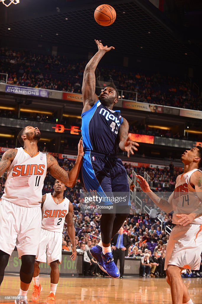 <a gi-track='captionPersonalityLinkClicked' href=/galleries/search?phrase=DeJuan+Blair&family=editorial&specificpeople=4649451 ng-click='$event.stopPropagation()'>DeJuan Blair</a> #45 of the Dallas Mavericks puts a shot up against the Phoenix Suns on December 21, 2013 at U.S. Airways Center in Phoenix, Arizona.