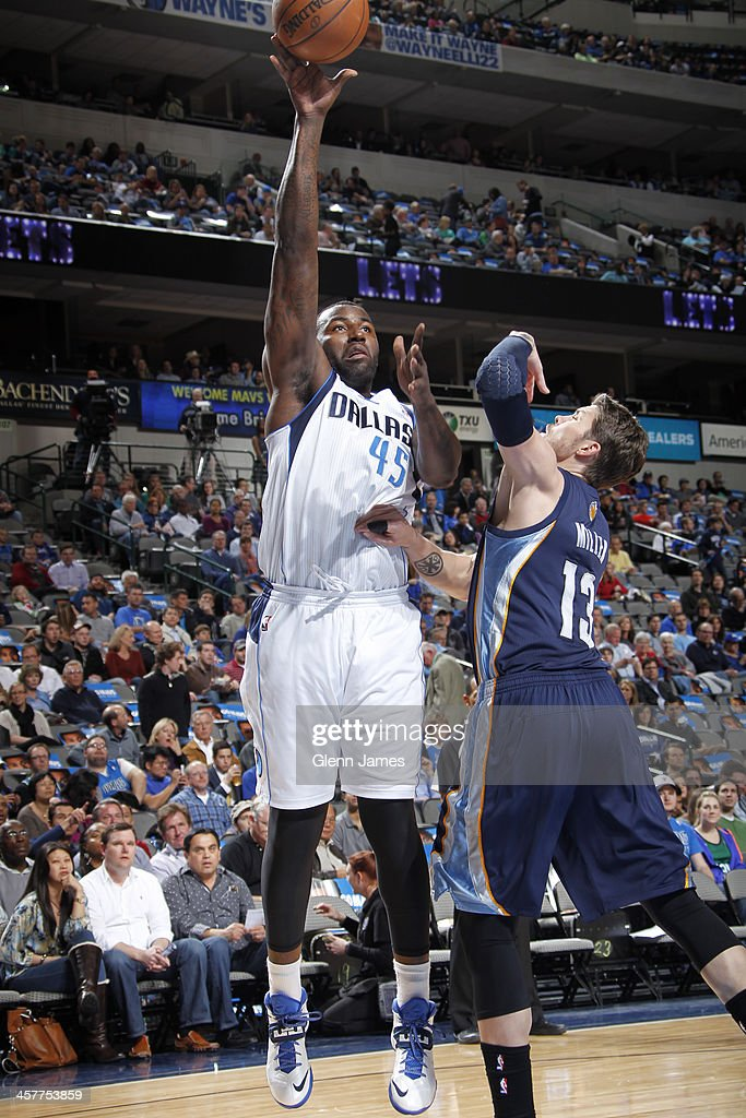 DeJuan Blair #45 of the Dallas Mavericks puts up the hook shot against the Memphis Grizzlies on December 18, 2013 at the American Airlines Center in Dallas, Texas.