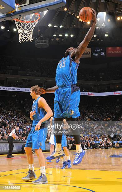 Dejuan Blair of the Dallas Mavericks rebounds against the Golden State Warriors on December 11 2013 at Oracle Arena in Oakland California NOTE TO...