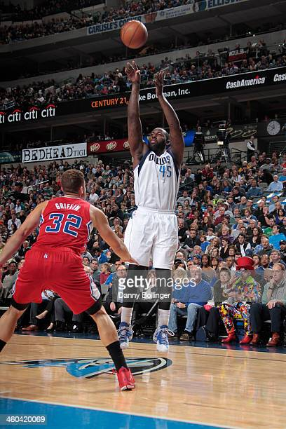 DeJuan Blair of the Dallas Mavericks shoots a jumper against Blake Griffin of the Los Angeles Clippers on January 3 2014 at the American Airlines...
