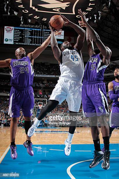 DeJuan Blair of the Dallas Mavericks shoots against Quincy Acy of the Sacramento Kings on January 31 2014 at the American Airlines Center in Dallas...