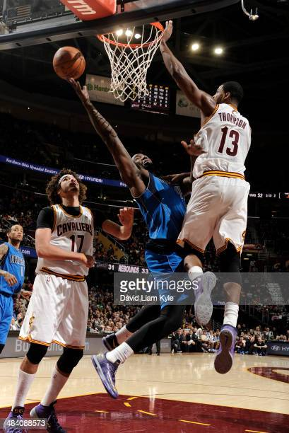 DeJuan Blair of the Dallas Mavericks shoots against Tristan Thompson of the Cleveland Cavaliers at The Quicken Loans Arena on January 20 2014 in...