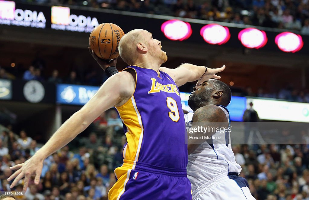 DeJuan Blair #45 of the Dallas Mavericks takes a shot against Chris Kaman #9 of the Los Angeles Lakers at American Airlines Center on November 5, 2013 in Dallas, Texas.