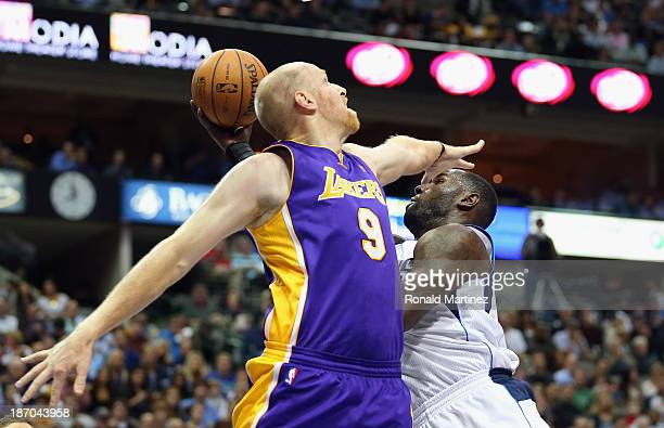 DeJuan Blair of the Dallas Mavericks takes a shot against Chris Kaman of the Los Angeles Lakers at American Airlines Center on November 5 2013 in...