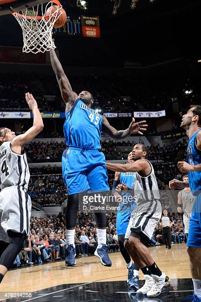 DeJuan Blair of the Dallas Mavericks takes a shot during a game against the San Antonio Spurs at the ATT Center on March 2 2014 in San Antonio Texas...
