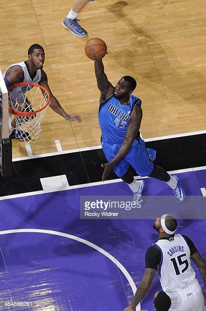 DeJuan Blair of the Dallas Mavericks takes the ball to the basket against the Sacramento Kings at Sleep Train Arena on December 9 2013 in Sacramento...