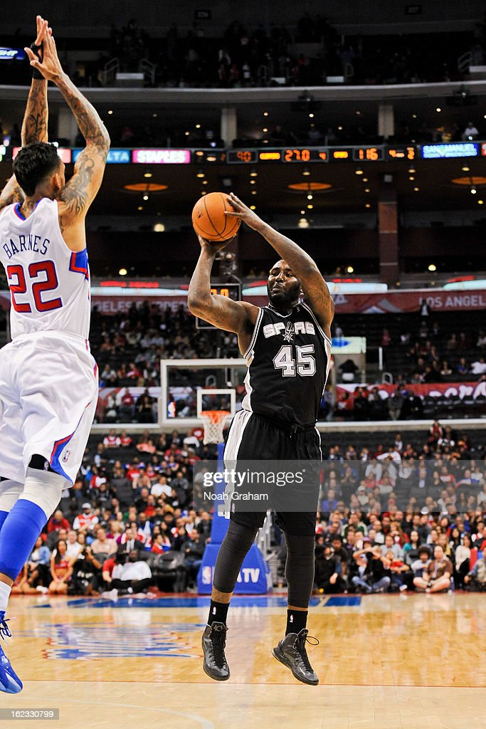 <a gi-track='captionPersonalityLinkClicked' href=/galleries/search?phrase=DeJuan+Blair&family=editorial&specificpeople=4649451 ng-click='$event.stopPropagation()'>DeJuan Blair</a> #45 of the San Antonio Spurs attempts a shot against <a gi-track='captionPersonalityLinkClicked' href=/galleries/search?phrase=Matt+Barnes+-+Basketball+Player&family=editorial&specificpeople=202880 ng-click='$event.stopPropagation()'>Matt Barnes</a> #22 of the Los Angeles Clippers at Staples Center on February 21, 2013 in Los Angeles, California.