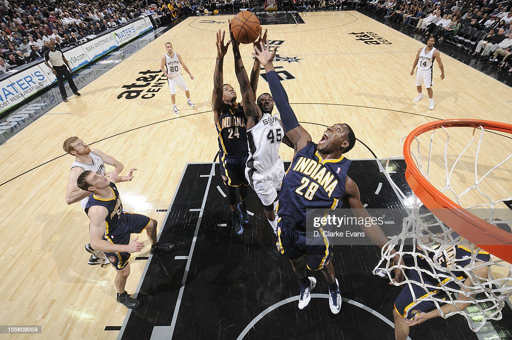 <a gi-track='captionPersonalityLinkClicked' href=/galleries/search?phrase=DeJuan+Blair&family=editorial&specificpeople=4649451 ng-click='$event.stopPropagation()'>DeJuan Blair</a> #45 of the San Antonio Spurs goes to the basket against <a gi-track='captionPersonalityLinkClicked' href=/galleries/search?phrase=Ian+Mahinmi&family=editorial&specificpeople=740196 ng-click='$event.stopPropagation()'>Ian Mahinmi</a> #28 of the Indiana Pacers during the game between the Indiana Pacers and the San Antonio Spurs on November 5, 2012 at the AT&T Center in San Antonio, Texas.